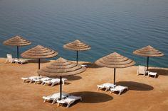 sun chairs and umbrellas near the Dead Sea