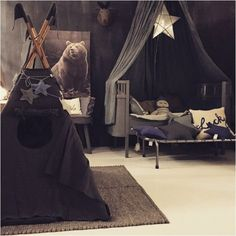 Even though dark tones aren't the first choice for a kids room, this room is so magical and enchanting. by Numero 74
