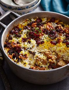 This lamb or mutton biryani is packed with spices, dried fruit and even rose petals! A melting pot of tender meat, rice, dried fruits and Kashmiri spices - great for treating special guests to a feast. Lamb Dishes, Rice Dishes, Indian Food Recipes, Asian Recipes, Kashmiri Recipes, Arabic Recipes, Biryani Recipe, Middle Eastern Recipes, Indian Dishes