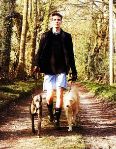 The fashion handsome guy and dog walking with