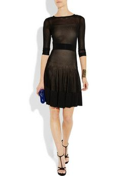 Not usually a fan of full skirts but, the sheerness of this dress counters the frilliness of the skirt which lends the look an edge.