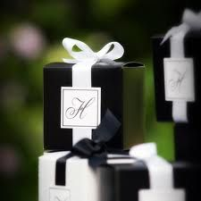 Gift boxes in elegant shiny black!!! Bebe'!!! With white satin ribbon and bows!!!