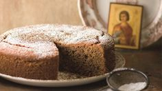 Fanouropita Recipe - A cake to honor St. Fanourios. Many Orthodox Christians pray to St. Fanourios when they want to find something. Read more at this link!