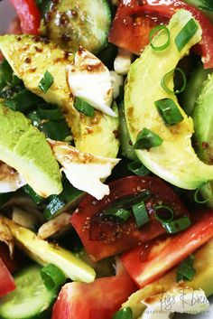 Avacado, tomato, cucumber, and mozzarella salad with balsamic vinegar and whole seed mustard dressing.  Balsamic vinegar mixed with wholeseed mustard. You can add a bit of honey and/or olive oil too.