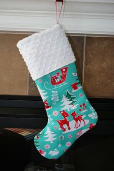 CHRISTMAS STOCKING - Red Reindeer on Aqua Christmas Stocking. via Etsy.