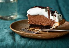 Mile-High Chocolate Pie  To get a super-light mousse, you'll need to properly fold together the whipped cream, egg whites, and melted chocolate. Check out our homemade pie crust recipe.