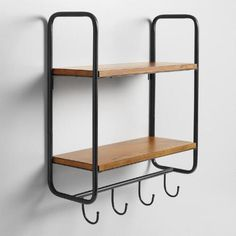Maximize organization in your kitchen or entryway with our versatile wall storage unit featuring a black metal frame, two wooden shelves and four hooks.