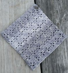 Four different bases combine to create a cowl that is fascinatingly textured, and the lace pattern is designed to be visually interesting even when the cowl is worked in just one base.
