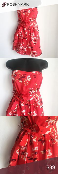 Express Floral Tie Waist Flowy Dress * Stretch Elastic Waist * Floral Print * Tie Waist * Strapless Elastic Bust * Lined  Size: 6 Color: Coral / Orange, Yellow, White Condition: Like New Material: 100% Polyester Lining: 95% Polyester 5% Spandex *Stock photo shown for Fit & Style*  Measurements Bust: 28 inches Waist: 26 inches Length: 27 inches All measurements are approximate.  No stains, rips, tears | Pet/Smoke free home. Offers welcomed ✨ Express Dresses Mini