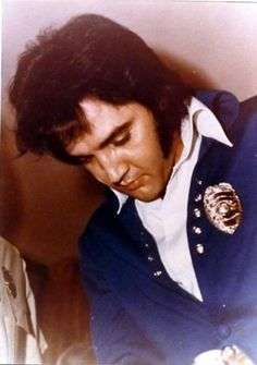 """Elvis getting his """"Kentucky County"""" police badge, April 16th 1970."""