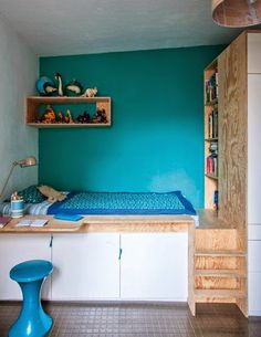 a built-in bed and bright wall in a kid's room.