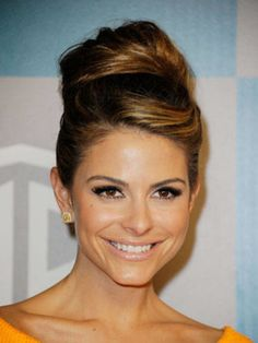 We love how Maria Menounos's bun resembles Audrey Hepburn's <em>Breakfast at Tiffany's</em> Style. To get her look, part your hair above the arch in your right eyebrow and sweep the hair along your hairline to the left. Brush the right side of your hair back with a boar bristle brush to create a smooth finish, and then gather your tresses into a pile on top of your crown. From there, loosely wind your hair around itself and pin it into place with a few bobby pins.