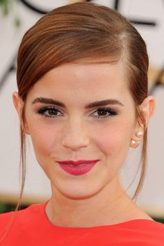 Golden Globes 2014: Emma Watson's Pink Lips and Sleek Chignon. The exact products she was wearing, plus how to recreate her hairstyle.
