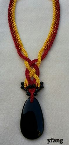 Black onyx in red and yellow Friendship macrame necklace