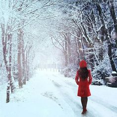 girl in red jacket looking down a snowy street a la Red Riding Hood in the 21st Century