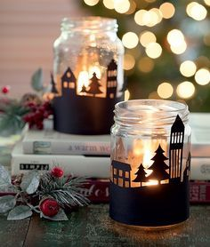 Luminárias feitas com potes de conserva e desenhos recortados no papel-cartão