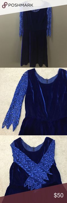 Royal blue velvet dress with crochet sleeves I'm becoming obsessed with velvet, so some of my dresses should go! Well, this one is a gem: it looks vintage (can't be sure, no tags), velvet is smooth and rich, color is amazing as well — deep royal blue, and those sleeves! There are a few pullings on the crochet simply due to its delicate nature, really hardly noticeable. Otherwise this dress is glorious! It fits S-M the best. Vintage Dresses Mini