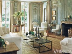 Warm patinaed walls complement plush chairs and wooden tables
