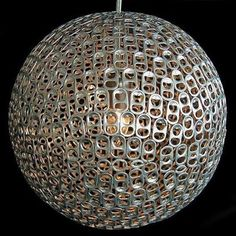- This modern, chic light pendent is created from recycled aluminum can pop tabs. By Mauricio Affonso. Recycle Cans, Ways To Recycle, Diy Pendant Light, Pendant Lamp, Pendant Lights, Soda Tabs, Pop Cans, Diy Chandelier, Trash To Treasure