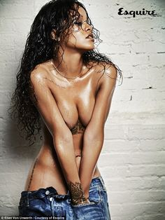Sizzling: Rihanna wears nothing more than a pair of low-rider denim jeans for a racy shoot...