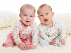 Two pesky monkeys -- er, babies -- playing together in our Girl's and Boy's Yoga Monkey print.  magnificentbaby.com