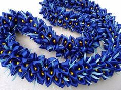 The lei is approximately 37 inches long material: satin ribbon and Color: royal blue, yellow, green Ribbon Lei, Organza Ribbon, Passion Fruit Flower, Candle Wedding Centerpieces, Flower Garlands, Graduation Gifts, Royal Blue, Blue Yellow, Green