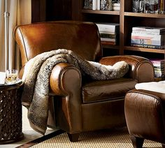 "Manhattan Leather Club Chair from Pottery Barn....otherwise known in my house as ""Mammas  reading chair"""
