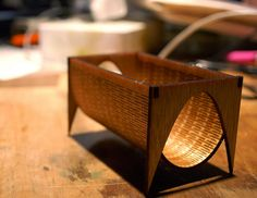 Laser cut business card holder...I think this would also make a nifty magazine rack