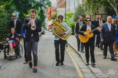 What a great idea! Hire a brass band to match your guests to the wedding reception!   Chelsea Physic Garden London, near the Thames. Ceremony at Chelsea Old Church.  Want to See more? Visit www.jamesandlianne.com Yorkshire based wedding photographers capturing the day how you remember it!