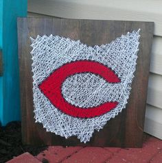 Sweet piece for the Reds fan in your life!    This string art is created on a piece of 16inX16in wood, stained to a dark brown. The Reds $80