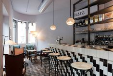 Dabass, nominated by Fabio Novembre    A 19th-century art-nouveau building in Porta Romana is the setting for this stylish bar, which is our final recommend from Novembre. It features retro interior details, from the monochrome tiled bar to the sculptural lighting pendants.