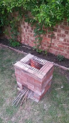 A below ground fire pit is ideal for slow cooking in cast for Brick rocket stove plans