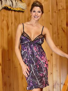 Strikingly attractive muddy girl camo chemise has a gentle flair to a mid-thigh length.Trimmed in black lace with a black bow accent, the The flirty ruffled hem finishes the look. Adjustable lingerie straps and a tie strap in the back provide the perfect fit. Made from soft, poly/spandex fabric .All available in S-XXL.