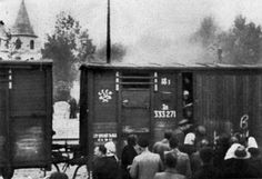 On Soviet orders, Latvians are loaded onto a train to be deported east to Siberia. 1941
