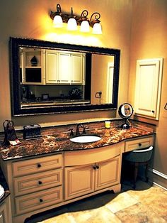 I love the idea of a make-up vanity built in to the vanity-needs 2 sinks tho