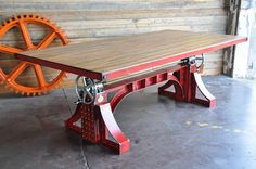 """Bronx table with reclaimed boxcar oak topStarting at $15,795 with a steel top Our flagship Bronx Crank Table features two massive 5-ton screw mechanisms and two 12"""" crank wheels that adjust the top from 30"""" dining height to 42"""" bar height."""