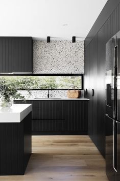 Dark joinery and pops of terrazzo steal the show in this modern home makeover. Terrazzo splashback in kitchen, window splashback in kitchen, black and white kitchen, modern kitchen, built in ovens in kitchen Black Kitchens, Home Kitchens, Kitchen Black, Modern Kitchens, Kitchen Modern, Interior Design Kitchen, Kitchen Decor, Modern Kitchen Designs, Design Exterior