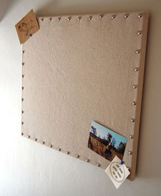 BURLAP MESSAGE BOARD Turn an old bulletin board or a painter's canvas reinforced with cork board into a chic burlap message board that looks...