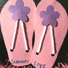 Cute summer craft! Construction paper and string.
