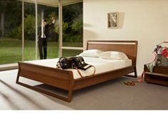 The best bed position: A solid wall behind you for support with easy views of the door and the windows.