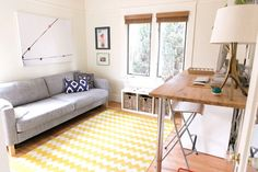 Office / guestroom with pull-out sofa and standing desk.   *be still my heart*