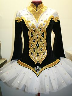 I love this dress. I love gold and black together. ^<>^                   -