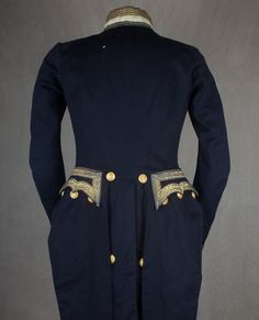 "Buttons and hidden pockets meant that long tails could be ""buttoned up"" when riding or in inclement weather. http://www.australiandressregister.org/media/cache/bd/f4/bdf45a8b758b812abacea12089f0c712.jpg"