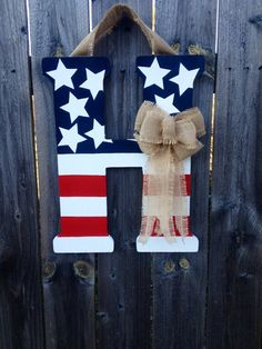 Patriotic Monogram Door Hanger with Burlap Bow- Red, White, & Blue on Etsy, $40.00