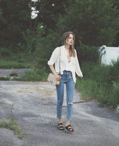 Sonja Esman wearing Birkenstocks paired with light wash jeans.