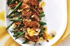Pork Tenderloin With Roasted Asparagus and Warm Citrus Sauce - Lean yet flavourful, pork tenderloin is a great choice if you're watching your calorie intake. Roasting the asparagus alongside the pork Entree Recipes, Pork Recipes, Lunch Recipes, Pasta Recipes, Vegetarian Recipes, Cooking Recipes, Healthy Recipes, Cooking Corn, Healthy Meals