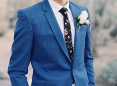Floral printed tie and a blue suit: http://www.stylemepretty.com/california-weddings/palm-springs/2016/04/12/this-bride-and-grooms-laid-back-attitude-led-to-in-the-prettiest-wedding/ | Photography: Christine Choi - http://christinechoi.com/