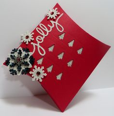 Stampin' Up Jolly Square Pillow Box created by Lynn Gauthier using Square Pillow Box and Christmas Greetings Thillits Dies. Go to http://lynnslocker.blogspot.com/2015/09/jolly-stampin-up-square-pillow-box.html to see the details for this project.
