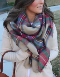 Fall style. Blanket plaid scarf over neutral colors
