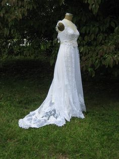 Hippie Lace Collage Gown in White One of a Kind with train and sash. $1,195.00, via Etsy.